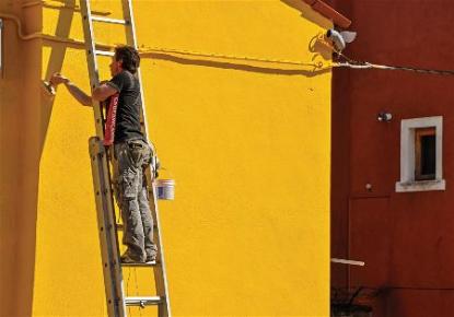 Yellow house painting in Rapid City South Dakota