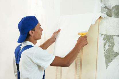 Man removing wallpaper in Rapid City South Dakota