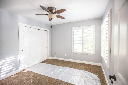 A light grey toned bedroom painted in Rapid City, South Dakota