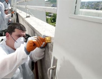 Painting the roof of a medical building in Rapid City South Dakota